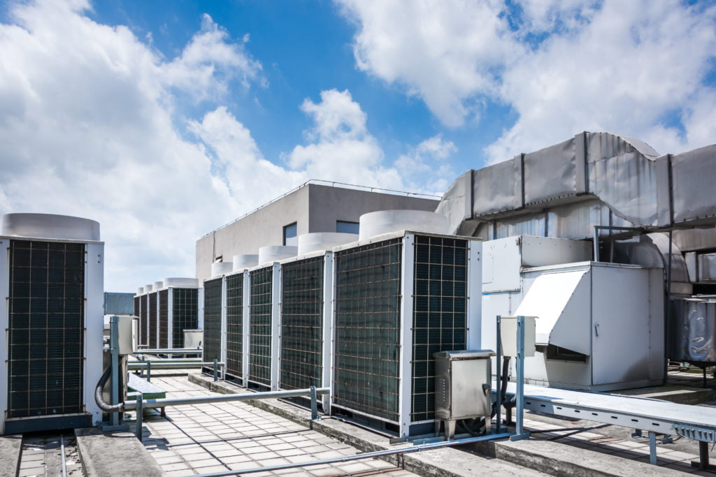 How Do Building Owners Decide to Replace vs. Repair HVAC Systems?